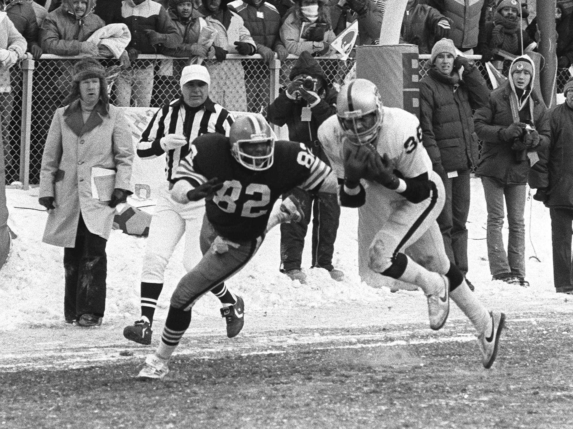 "Jan. 4, 1980: Oakland Raiders defensive back Mike Davis (36) cuts in front of Cleveland Browns tight end Ozzie Newsome to intercept a pass from Browns quarterback Brian Sipe in the end zone with less than a minute to go in an AFC divisional playoff game in Cleveland.  The Raiders won the game, 14-12, that would become known as ""Red Right 88."""