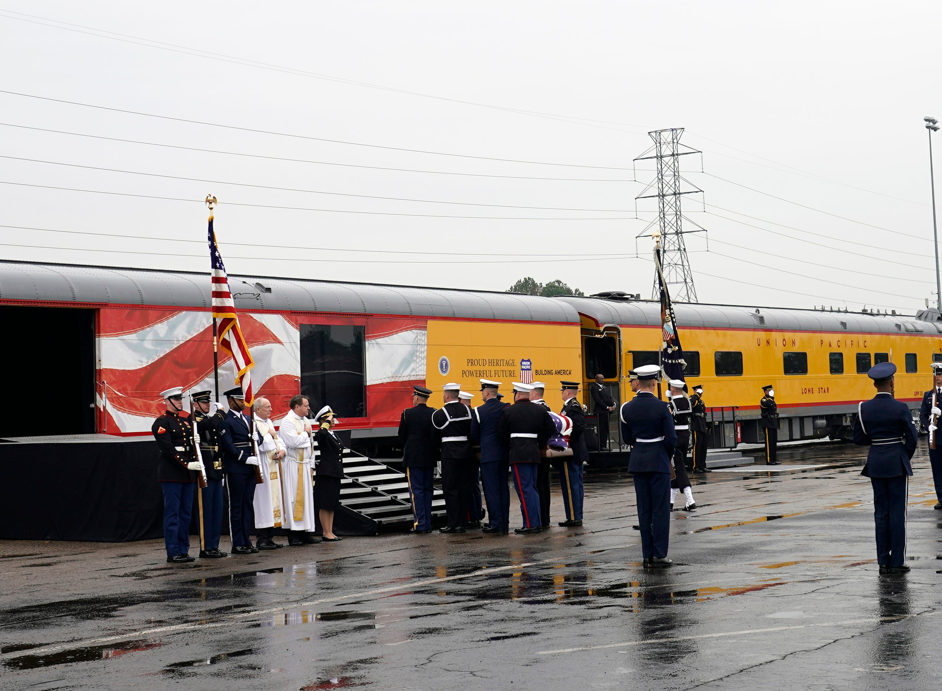 The flag-draped casket of former President George H.W. Bush is carried by a joint services military honor guard on Dec. 6, 2018 in Houston, Texas. President Bush will be buried at his final resting place at the George H.W. Bush Presidential Library at Texas A&M University in College Station, Texas. A WWII combat veteran, Bush served as a member of Congress from Texas, ambassador to the United Nations, director of the CIA, vice president and 41st president of the United States.