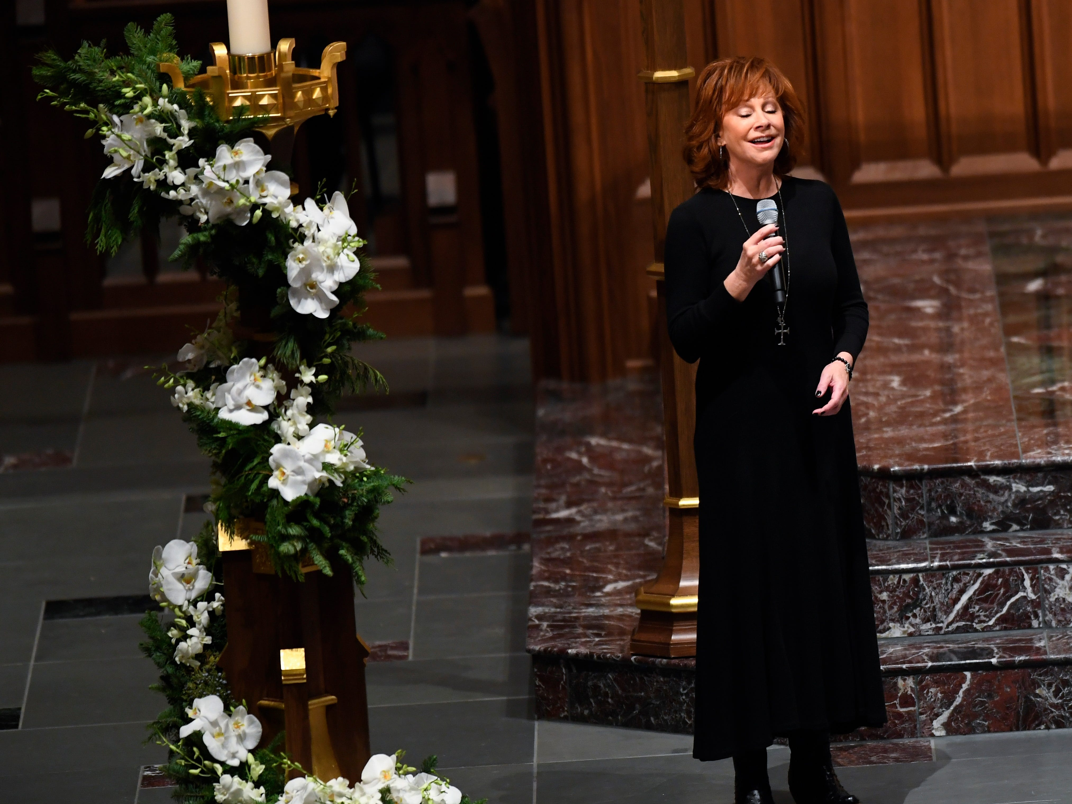 Reba McEntire sings at the funeral service for former President George H.W. Bush at St. Martin's Episcopal Church in Houston, Dec. 6, 2018.