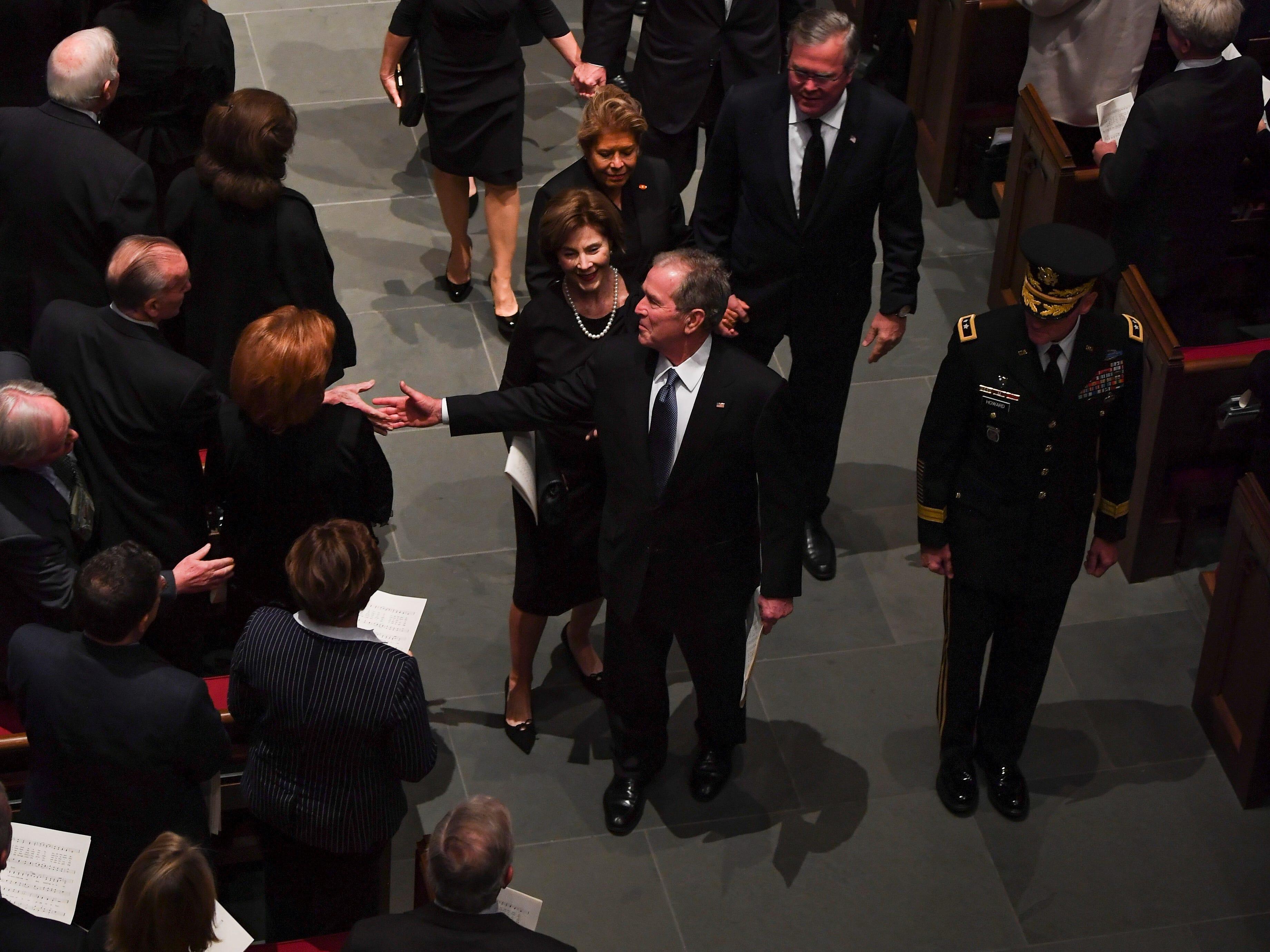 Former President George W. Bush and family depart the funeral service for former President George H.W. Bush at St. Martin's Episcopal Church in Houston, Thursday, Dec. 6, 2018.