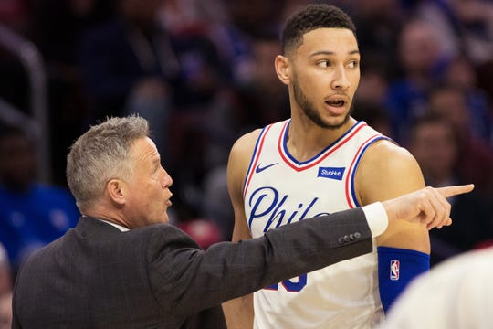 Philadelphia 76ers head coach Brett Brown talks with guard Ben Simmons.