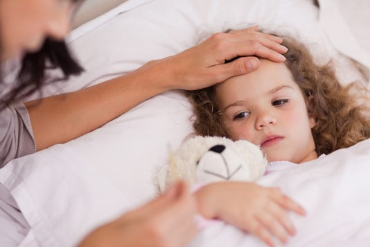Mother Taking Care Of Her Ill Daughter