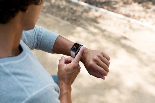 A user checks his Apple Watch