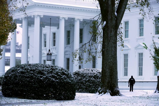 Snow and sleet from Winter Storm Avery covers the ground at the White House on Nov. 15, 2018 in Washington, DC.