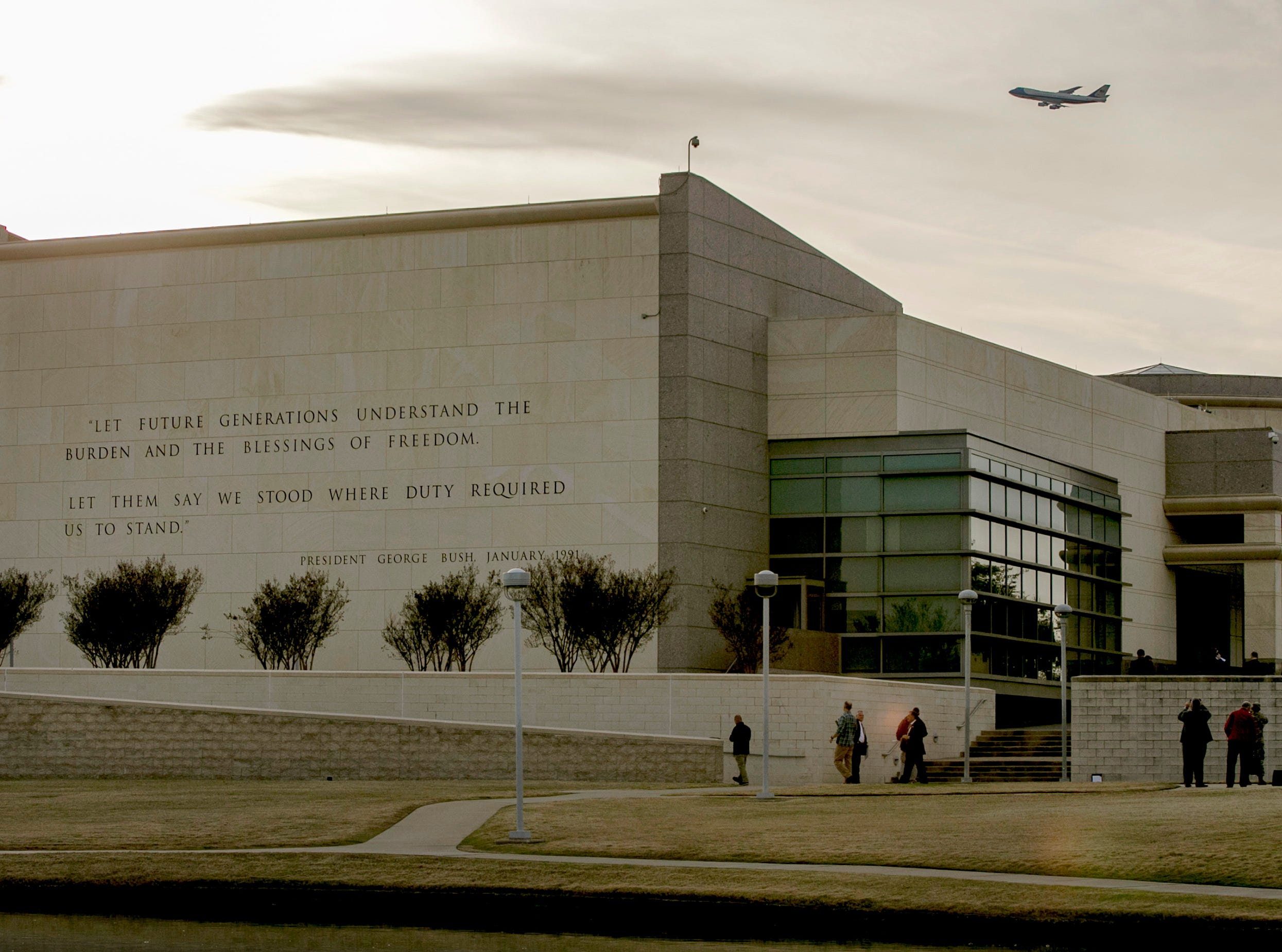 Special Air Mission 41 carries the body of President George H.W. Bush over the George H.W. Bush Presidential Library at Texas A&M University in College Station, Texas, on Wednesday, Dec. 5, 2018, the day before he will be buried there.