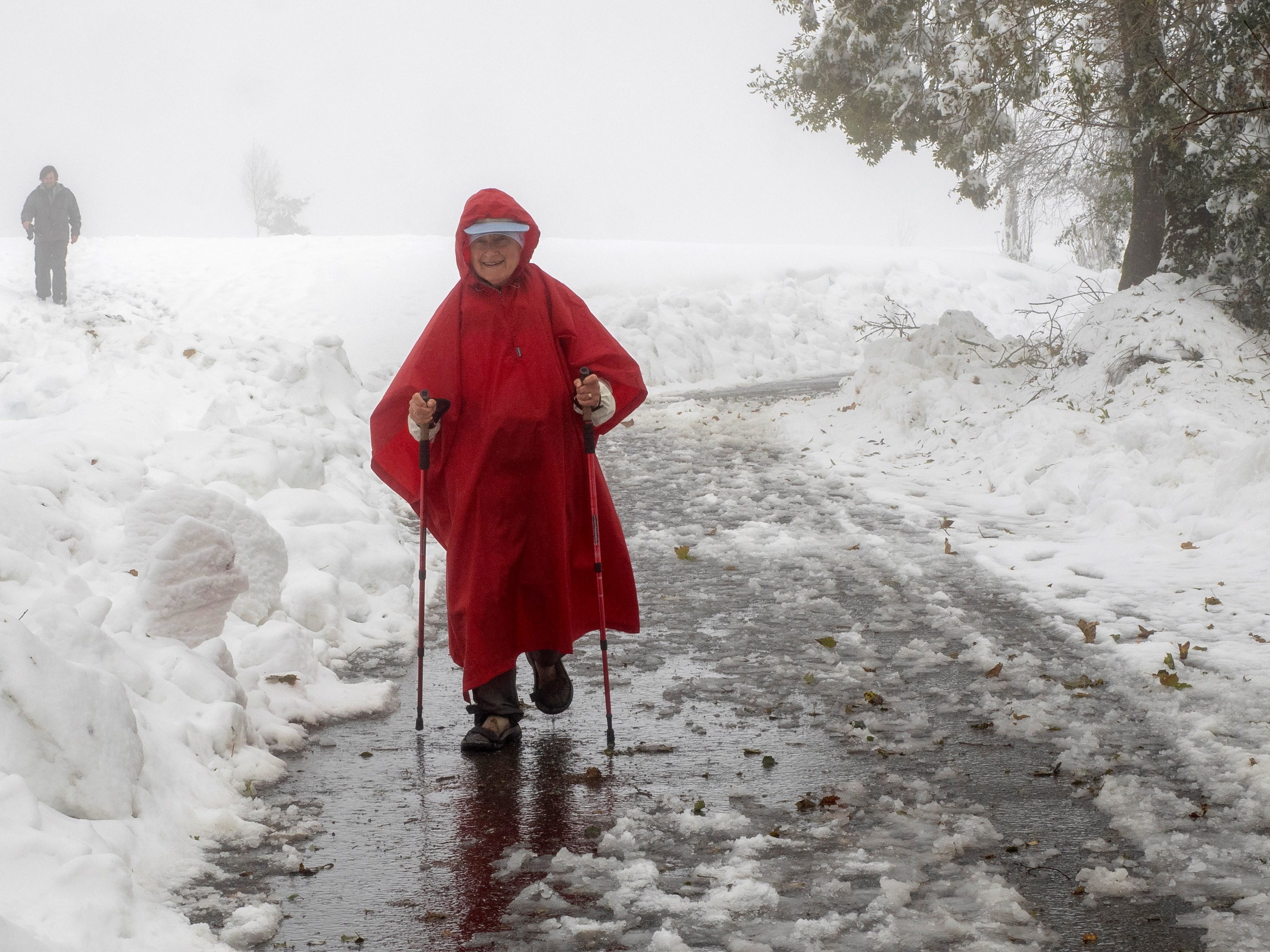 A pilgrim arrives in Pedrafita do Cebreiro village, covered with snow, in Galicia, northwestern Spain on Oct. 30, 2018.