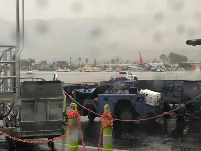 A Southwest Airlines plane apparently skidded off the runway Thursday during rainy weather in southern California, according to passenger reports.