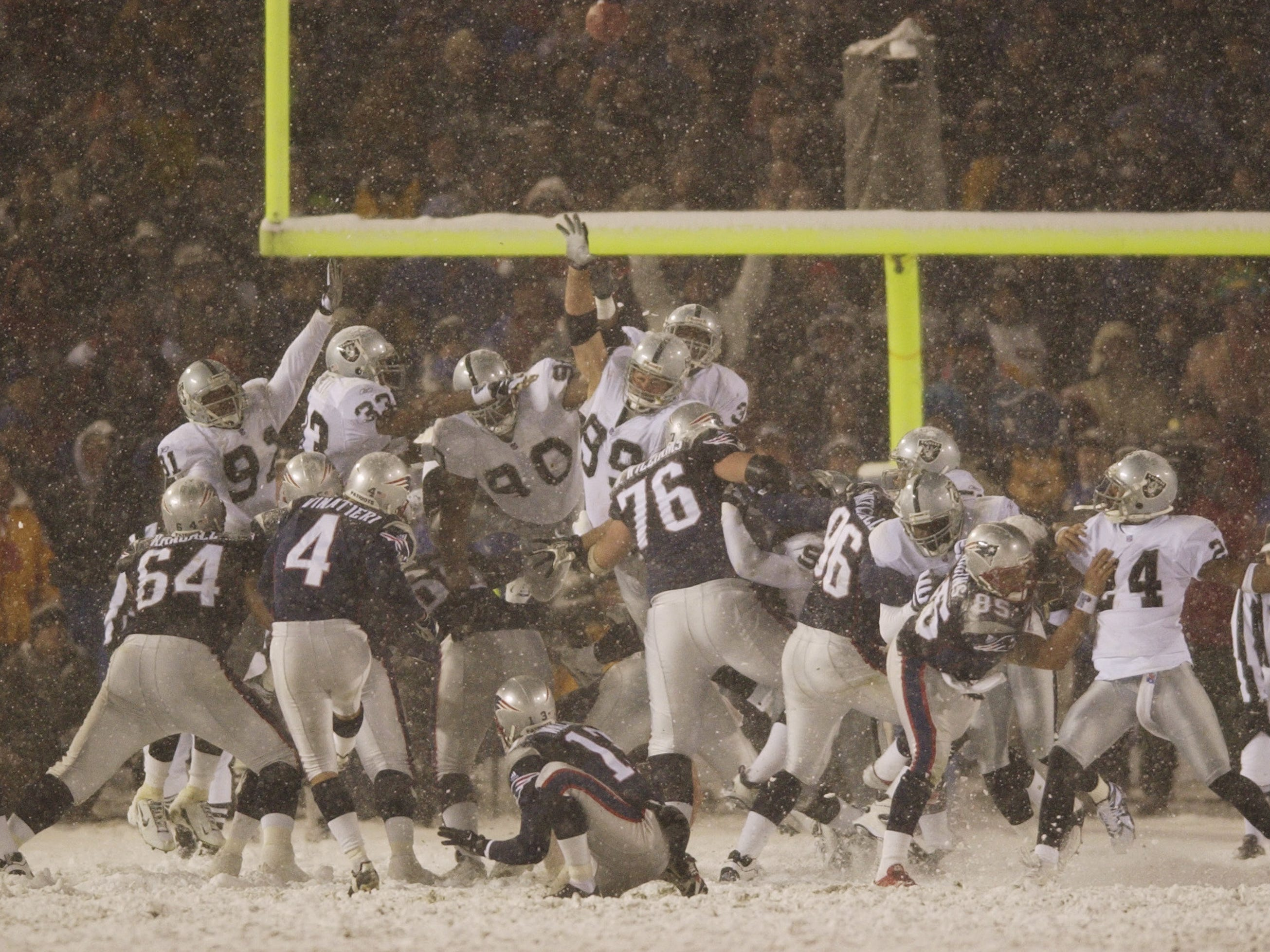 "Jan. 19, 2002: Adam Vinatieri #kicks the winning field goal against the Oakland Raiders in the 2001 AFC divisional playoff game at Foxboro Stadium. The Patriots won, 16-13, in overtime in the famous ""Tuck Rule"" game."