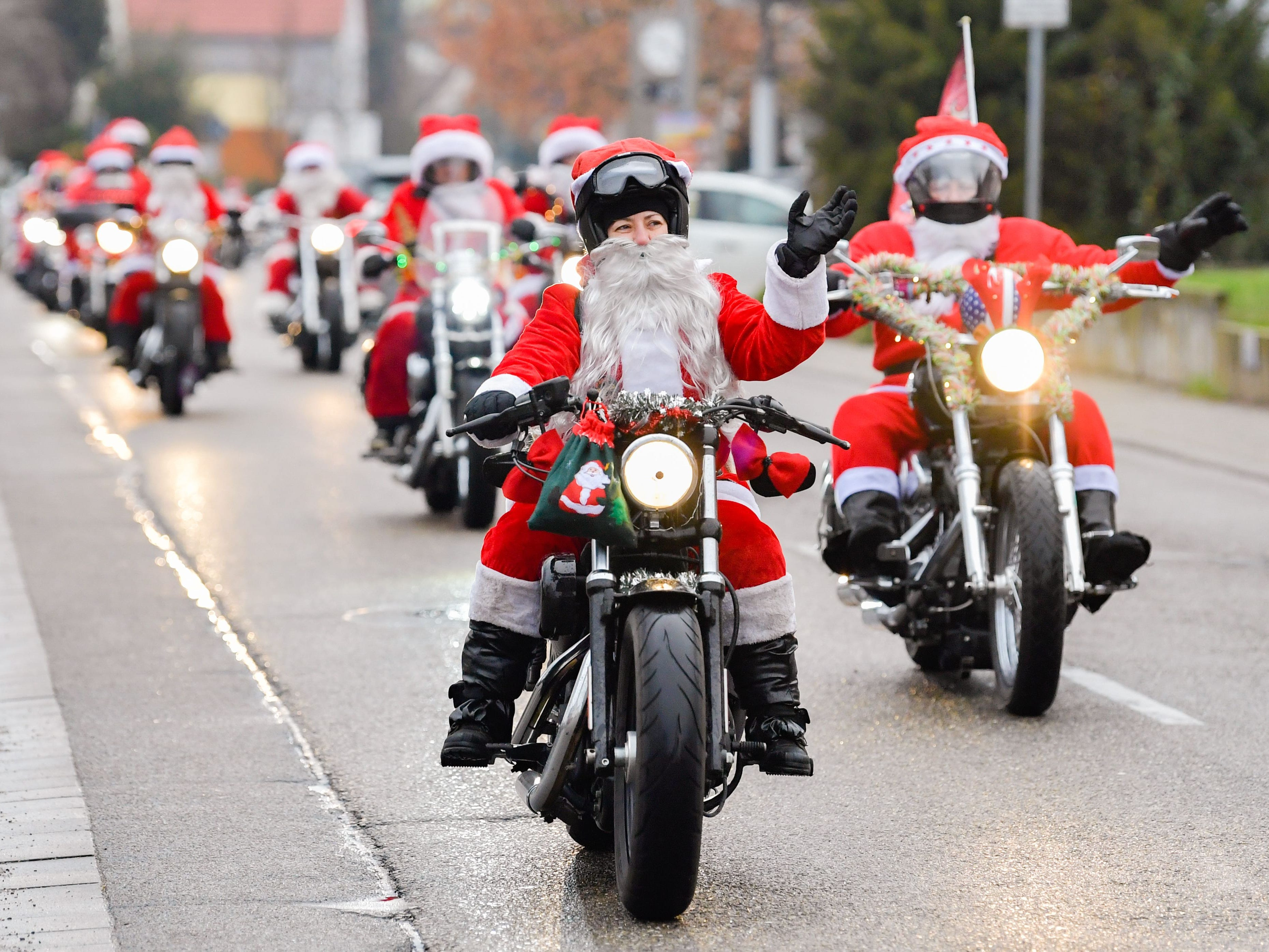"""Motor cyclist ride during a charity event titled """"Harley Davidson riding Santas"""" Dec. 6, 2018 in Lustadt, Germany."""