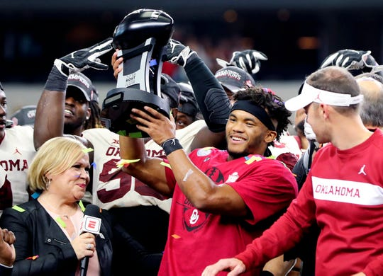 Oklahoma quarterback Kyler Murray  celebrates after being named the most outstanding player in the Big 12 Championship game. Could he be hoisting the Heisman next?
