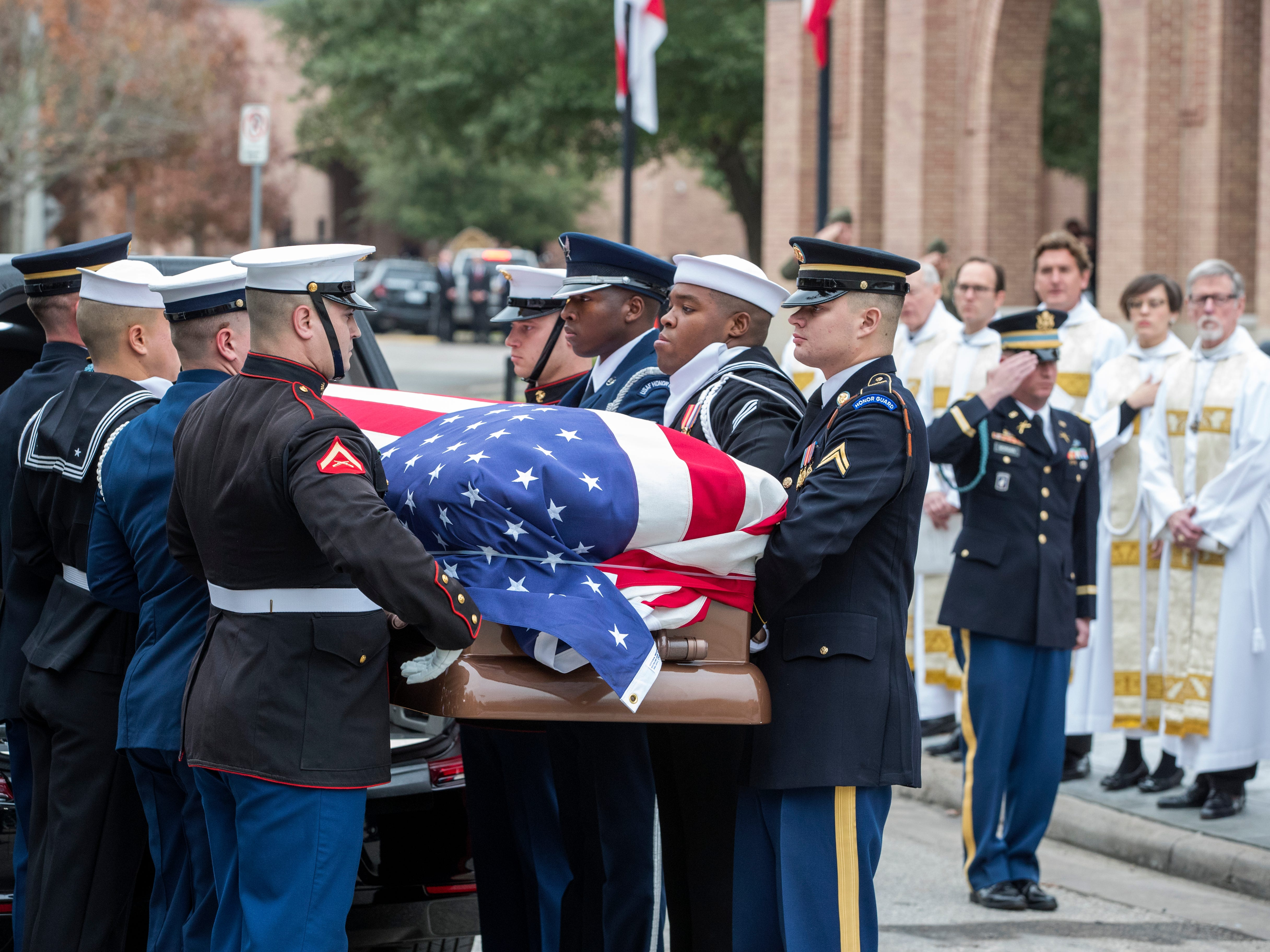 U.S. Service Members with the Ceremonial Honor Guard carry the casket of former President George H.W. Bush at the Funeral Service, St. Martin's Episcopal Church in Houston on Dec. 6, 2018.
