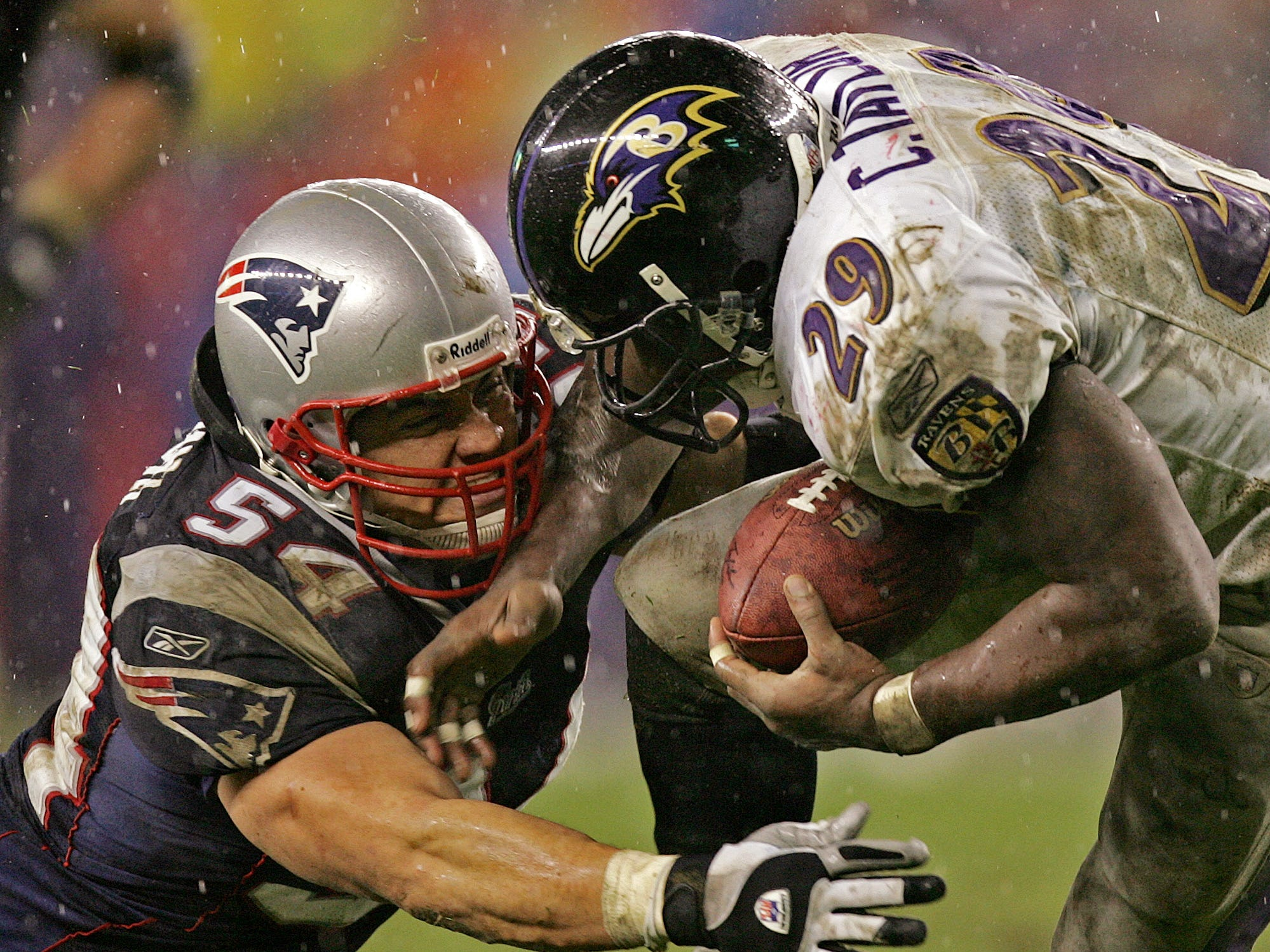 Nov. 28, 2004: New England Patriots linebacker Tedy Bruschi hits Baltimore Ravens running back Chester Taylor during the third quarter of the Patriots' 24-3 win at Gillette Stadium.