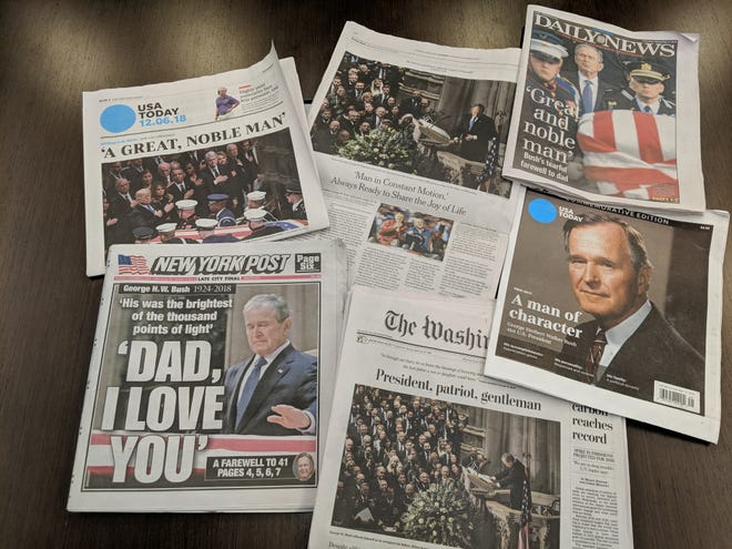 USA TODAY, The Washington Post, the New York Daily News, the New York Times, the New York Post and a USA TODAY commemorative tab show images from George H.W. Bush's state funeral.