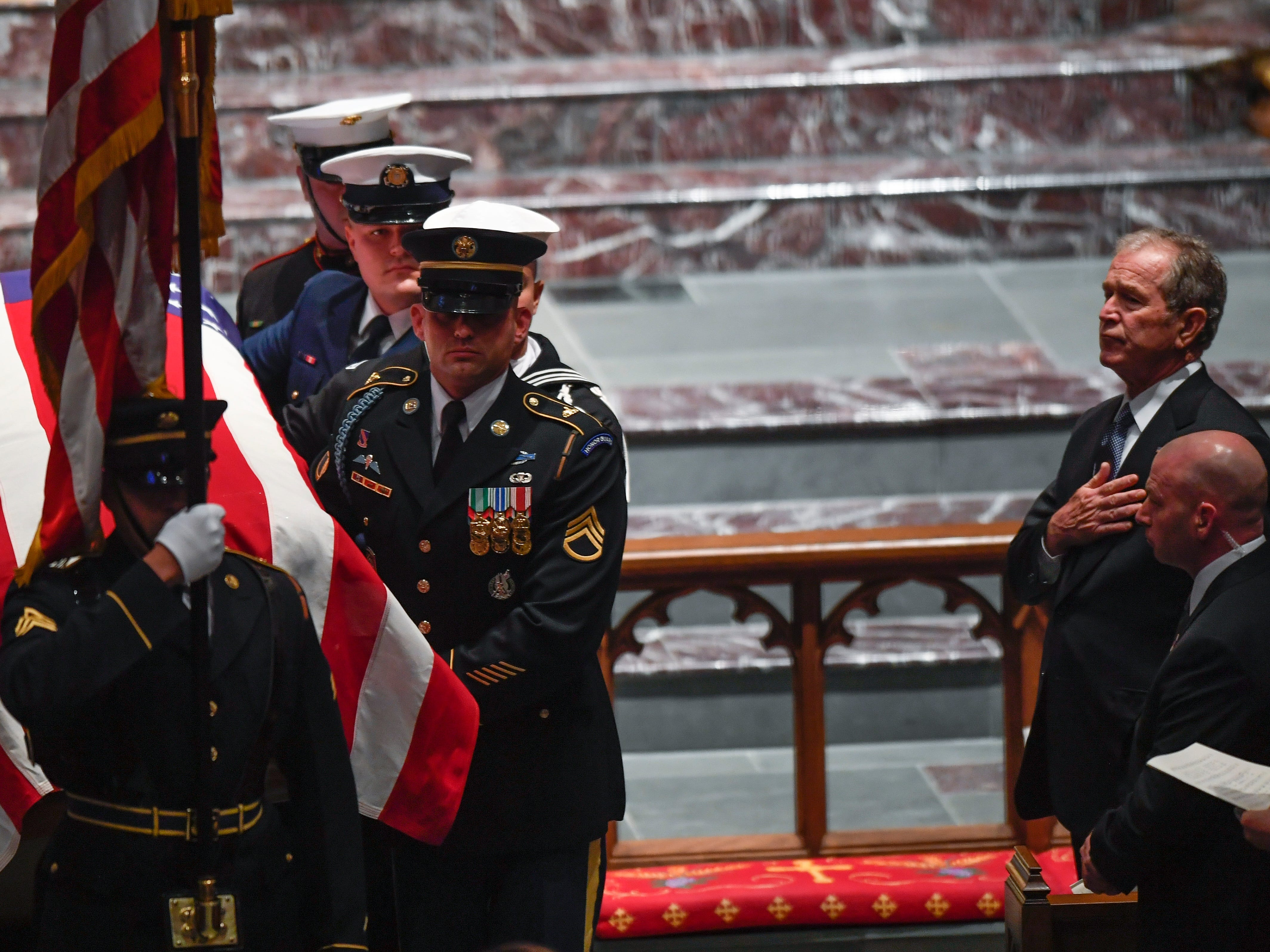 Former President George W. Bush watches at the conclusion of the funeral service for former President George H.W. Bush at St. Martin's Episcopal Church in Houston, Thursday, Dec. 6, 2018.