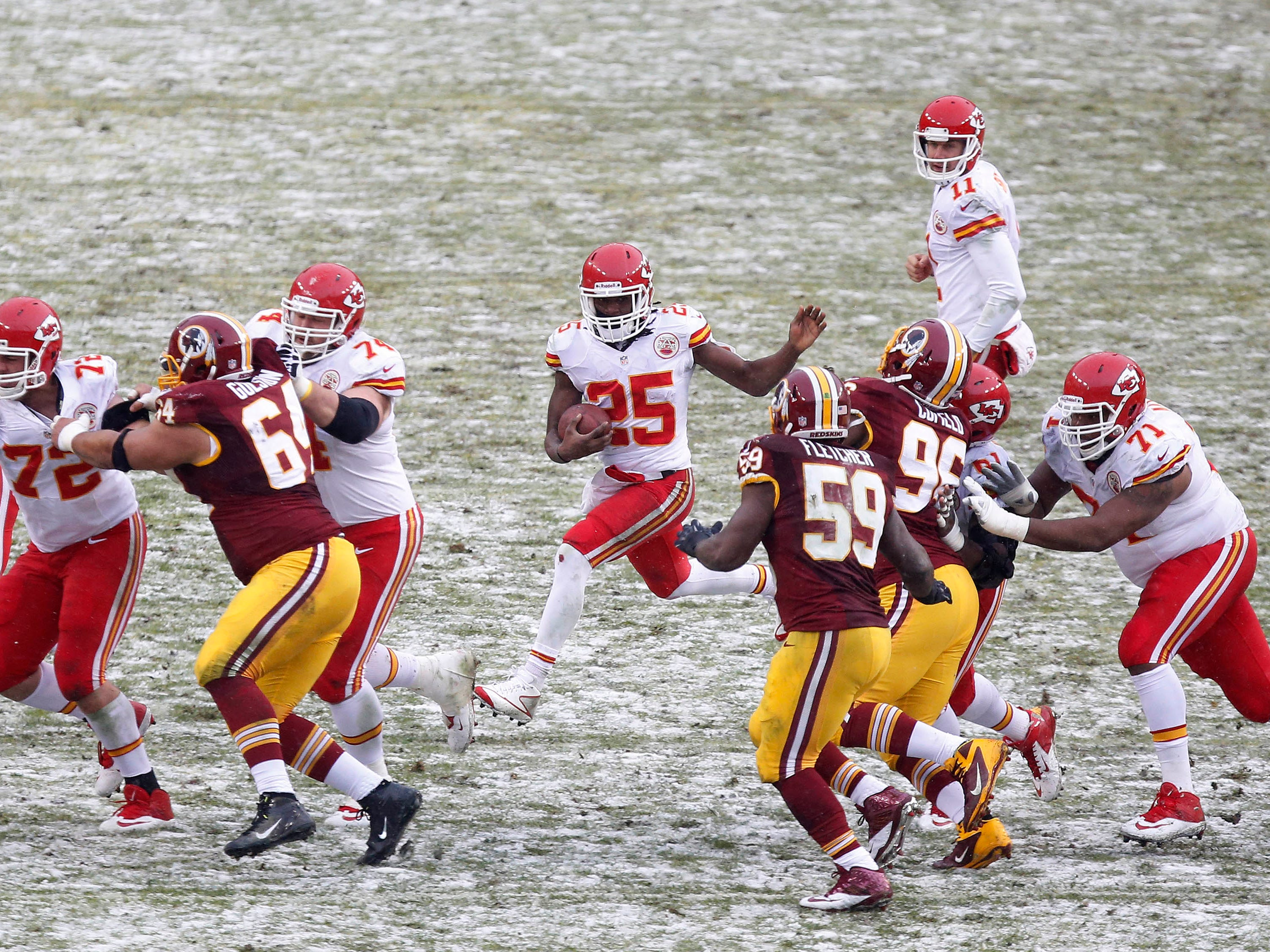 Dec. 8, 2013: Kansas City Chiefs running back Jamaal Charles (25) carries the ball against the Washington Redskins in the snow at FedEx Field. The Chiefs won the game, 45-10.