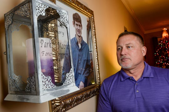 Andy Moore keeps a candle lit at his home in Anderson for his slain son Parker Killian Moore.