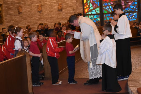 Father Chad Partain Pastor Of St Frances Cabrini Church Collects Donations From St Frances Cabrini School Students During Mass Friday Dec 7 2018 Each Year We Do An Advent Silver Coin Collection Where Students Bring In Funds To Assist Others In A Different Part Of The World Said Clayton Cobb Dean Of Students Some People Think That This Is A Time Of Receiving But This Is A Season Of Giving During The Advent Season Cobb Said The School Helps Out Missionary Companies Around The World Cross Catholic Outreach Is The Charity The School Is The Non Profit Organization The School Is Helping This Year They Have A Project Called Home For Christmas Said Cobb And Our School Is Looking To Provide The Funds To Build A Home For A Family In Haiti The Poorest Country In North America Each Week During The Advent Season Funds Will Be Collected At Mass For Homes For Christmas Hopefully We Can Provide The Home That Is Needed He Said