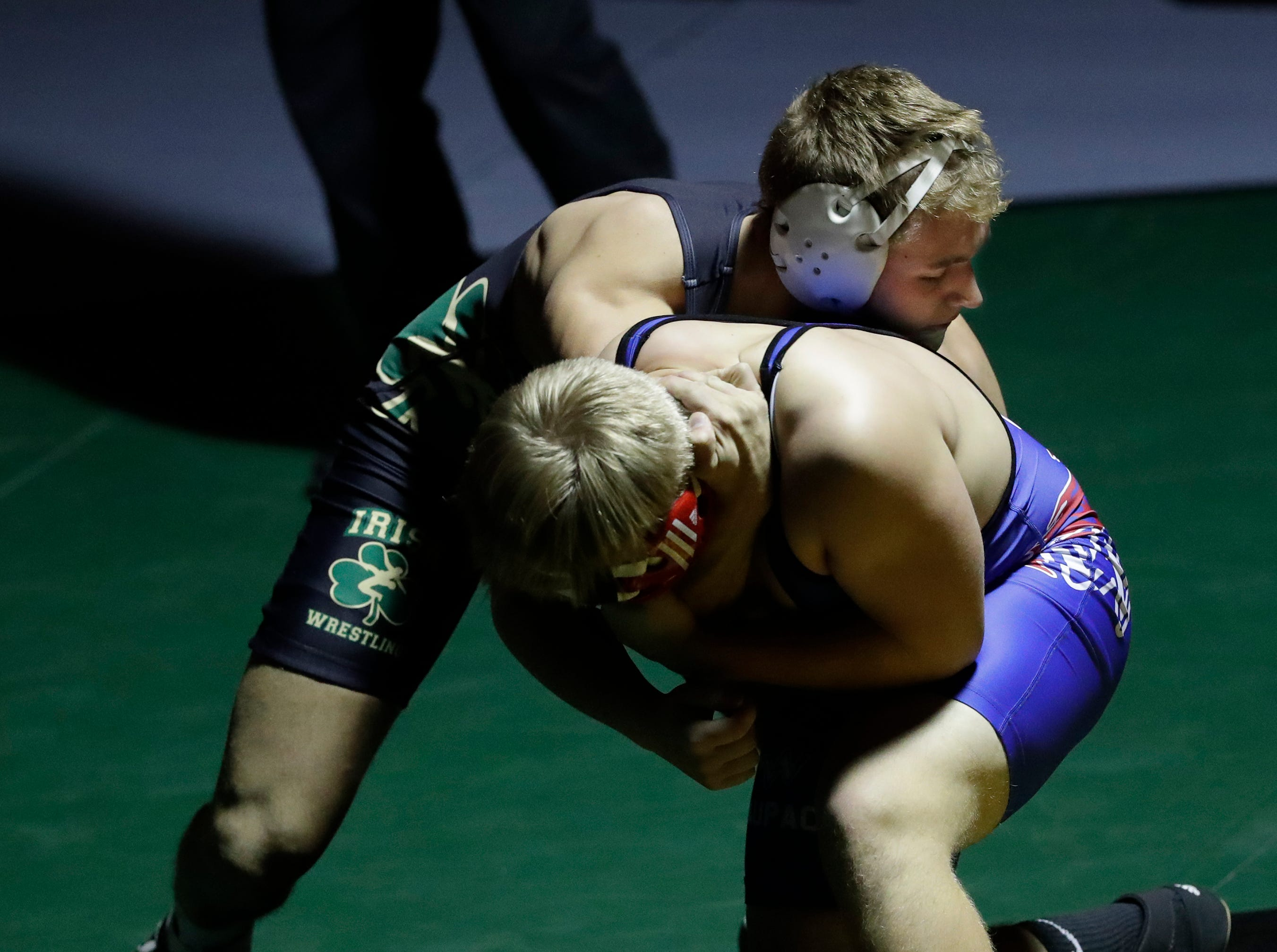 Freedom High School's Sam Peters, back, wrestles against Waupaca High School's Gabe Pierotti during their 170-lb wrestling match Thursday, December 6, 2018, in Freedom, Wis. 