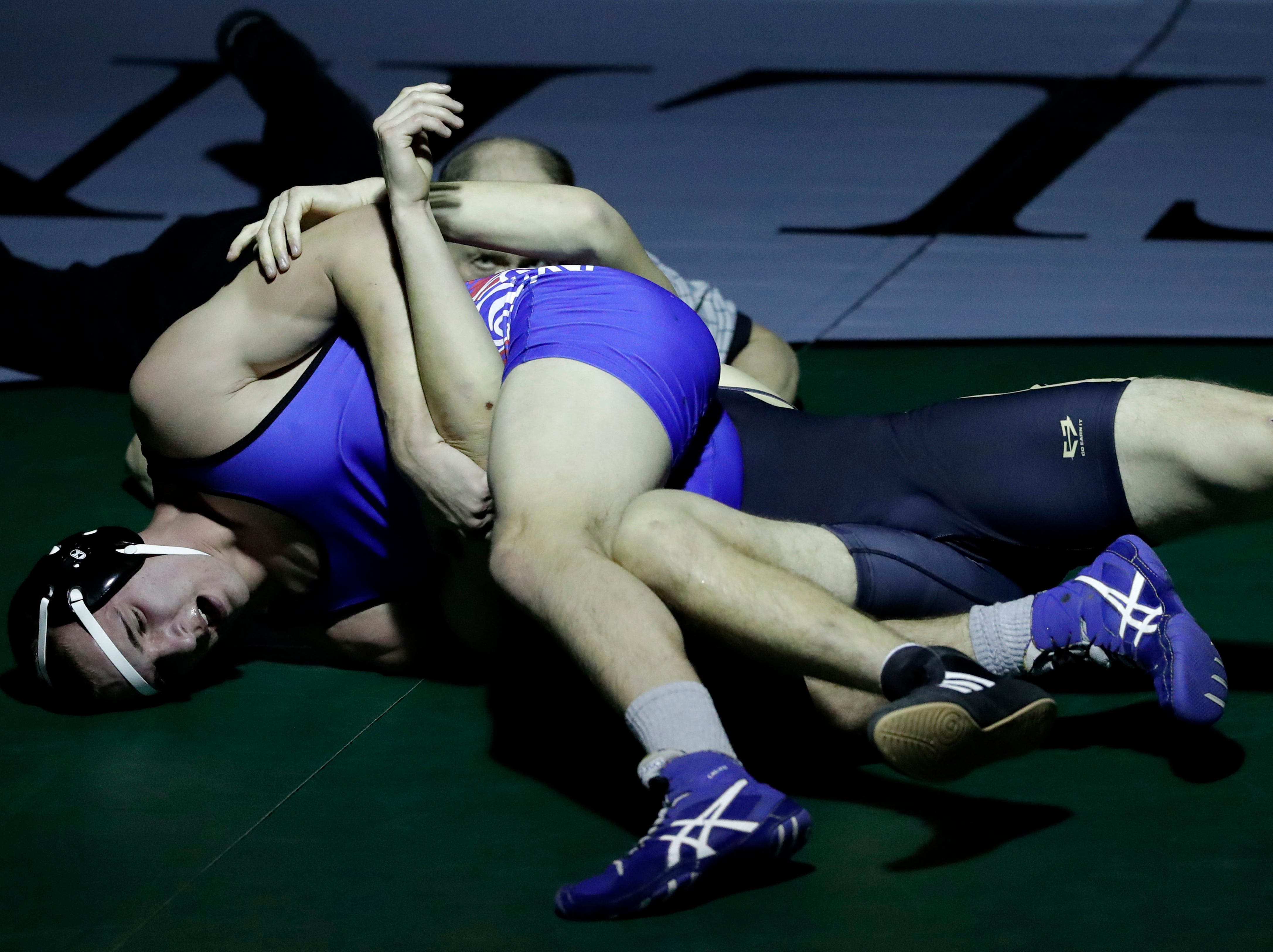 Freedom High School's Devan VanRossum, bottom, wrestles against Waupaca High School's Brock Sanger during their 195-lb wrestling match Thursday, December 6, 2018, in Freedom, Wis. 