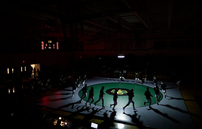Freedom High School's wrestling team enters the gym against Waupaca High School at the start of their wrestling meet Thursday, December 6, 2018, in Freedom, Wis. 