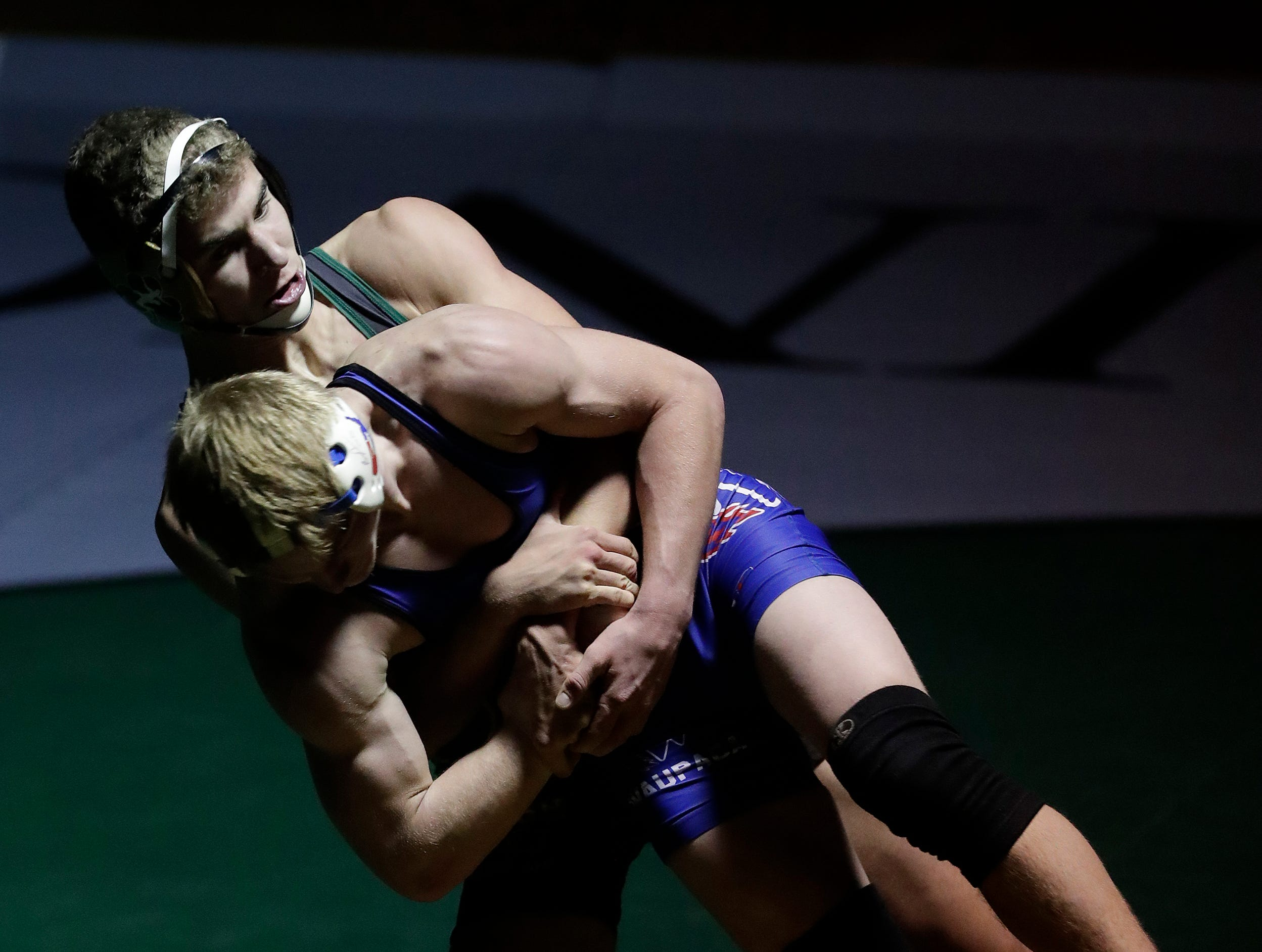 Freedom High School's Koy Murphy, back, wrestles against Waupaca High School's Colby Bernhardt during their 132-lb wrestling match Thursday, December 6, 2018, in Freedom, Wis. 