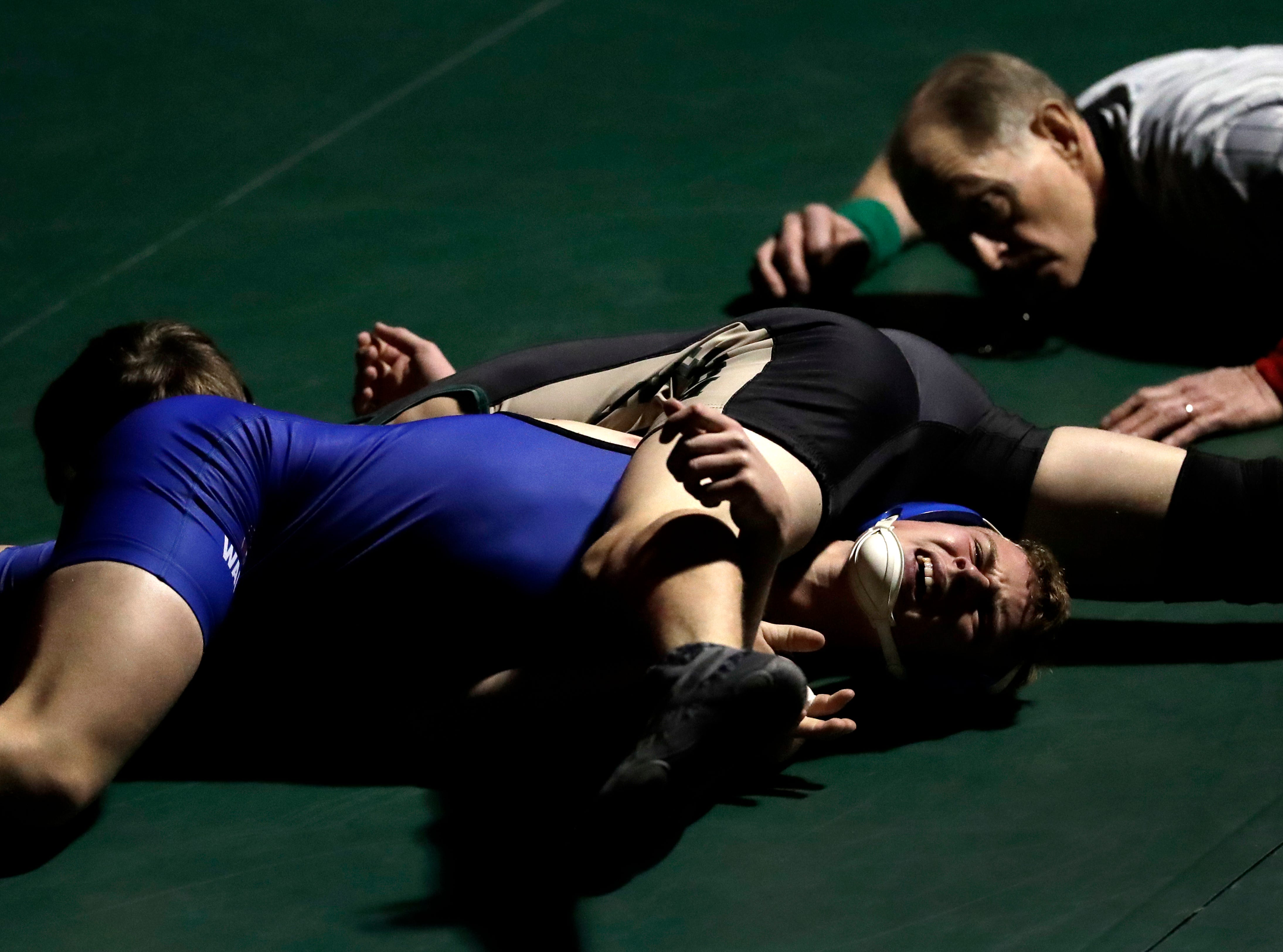 Freedom High School's Ben Bredael, top, wrestles against Waupaca High School's Devan Eisentraut during their 138-lb wrestling match Thursday, December 6, 2018, in Freedom, Wis. 