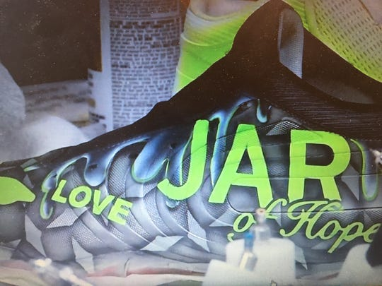 Derek Rivers' cleats promoting JAR of Hope, a Manalapan-based charity