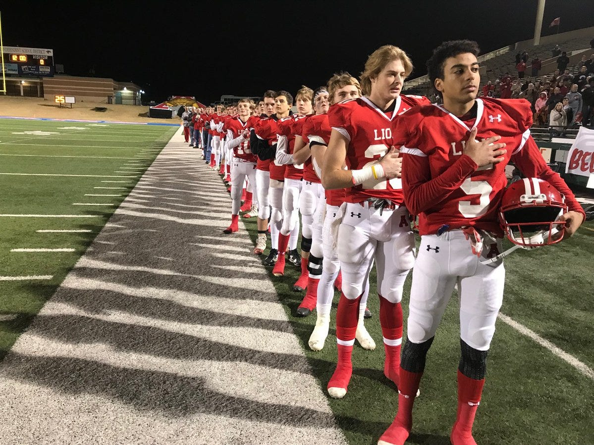 The Albany Lions stand for the National Anthem at Shotwell Stadium on Thursday, Dec. 6, 2018, before a playoff game against Hamlin Pied Pipers.