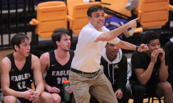 First-year Abilene High coach Justin Reese coaches his team against Cooper at the Catclaw Classic on Friday at Wylie's Bulldog Gym. Cooper won the game 69-65 in overtime in Reese's first crosstown game as Eagles coach.