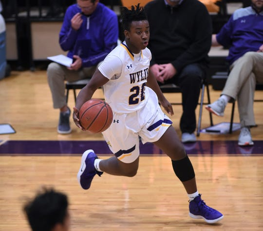 Wylie guard Isaiah Novil (20) makes a move against San Angelo Lake View to open the Catclaw Classic in Bulldog Gym. The Bulldogs won 73-31 and continue play on Friday.