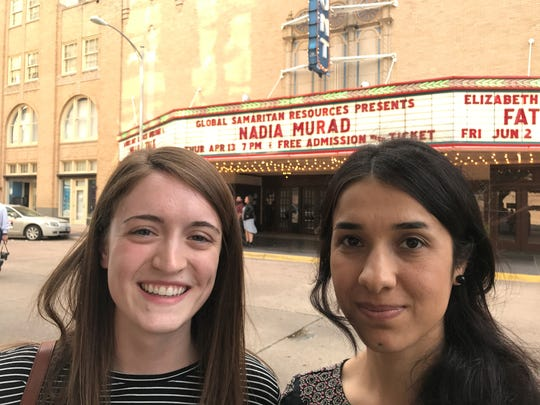 Hannah Sims, daughter of Danny and Suzanne Sims, with Nadia Murad outside the Paramount Theatre in April 2017, when Murad spoke.