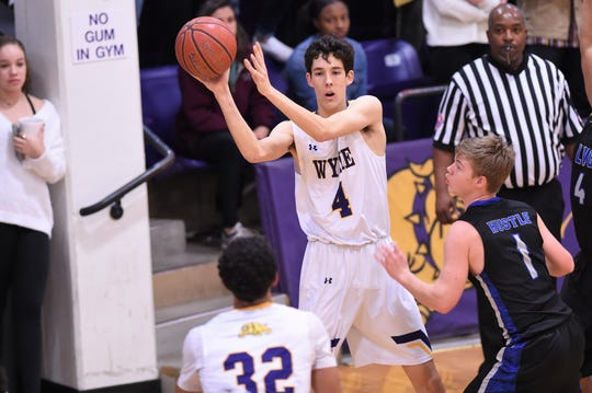 Wylie's Austin Brewer (4) passes out of the lane against San Angelo Lake View to open the Catclaw Classic in Bulldog Gym. The Bulldogs won 73-31 and continue play on Friday.