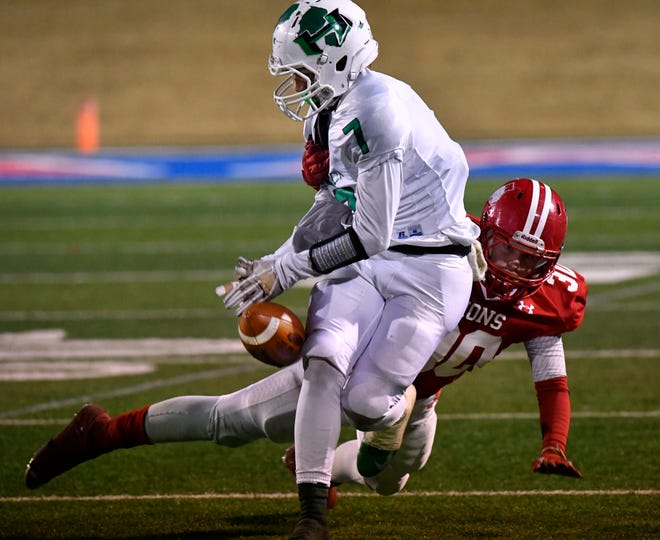 Albany linebacker Brooks Neece forces a fumble after tackling Hamlin wide receiver Austin Brown late in the game Thursday Dec. 7, 2018. The fumbled ball was recovered by safety Ben West and ran in for a 43-yard touchdown during the Class 2A Division II quarterfinal game at Shotwell Stadium. Final score was 41-28, Albany.