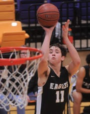 Abilene High's Cole McDowell shoots a jumper against Cooper during the Catclaw Classic on Friday at Wylie's Bulldog Gym. Cooper won the game 69-65 in overtime.