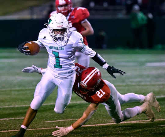 Hamlin wide receiver Jevon Williams is tackled by Albany linebacker Cutter Edgar during Thursday's Class 2A Division II quarterfinal game at Shotwell Stadium Dec. 6, 2018. Final score was 41-28, Albany.