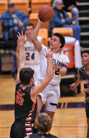 Wylie guard Shayden Payne (22) goes up for a basket during a 58-38 win against Brook Hill on the second day of the Catclaw Classic at Bulldog Gym. The tournament wraps up on Saturday.