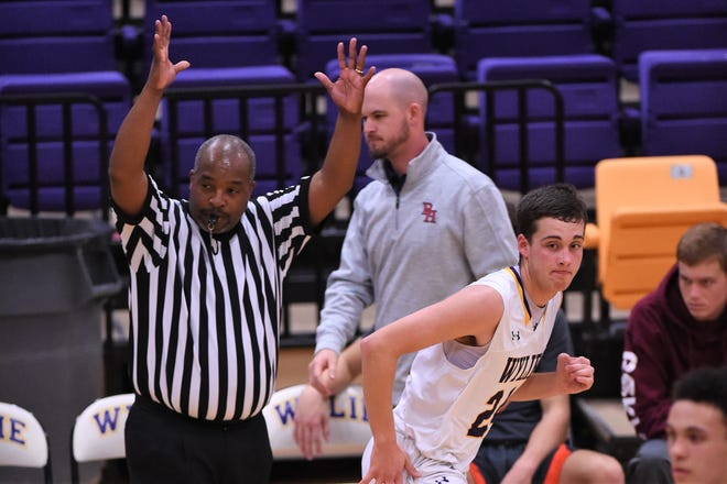 Wylie's Duncan Bacon (24) runs past an official after making a 3-point shot during a 58-38 win against Brook Hill on the second day of the Catclaw Classic at Bulldog Gym. The tournament wraps up on Saturday.