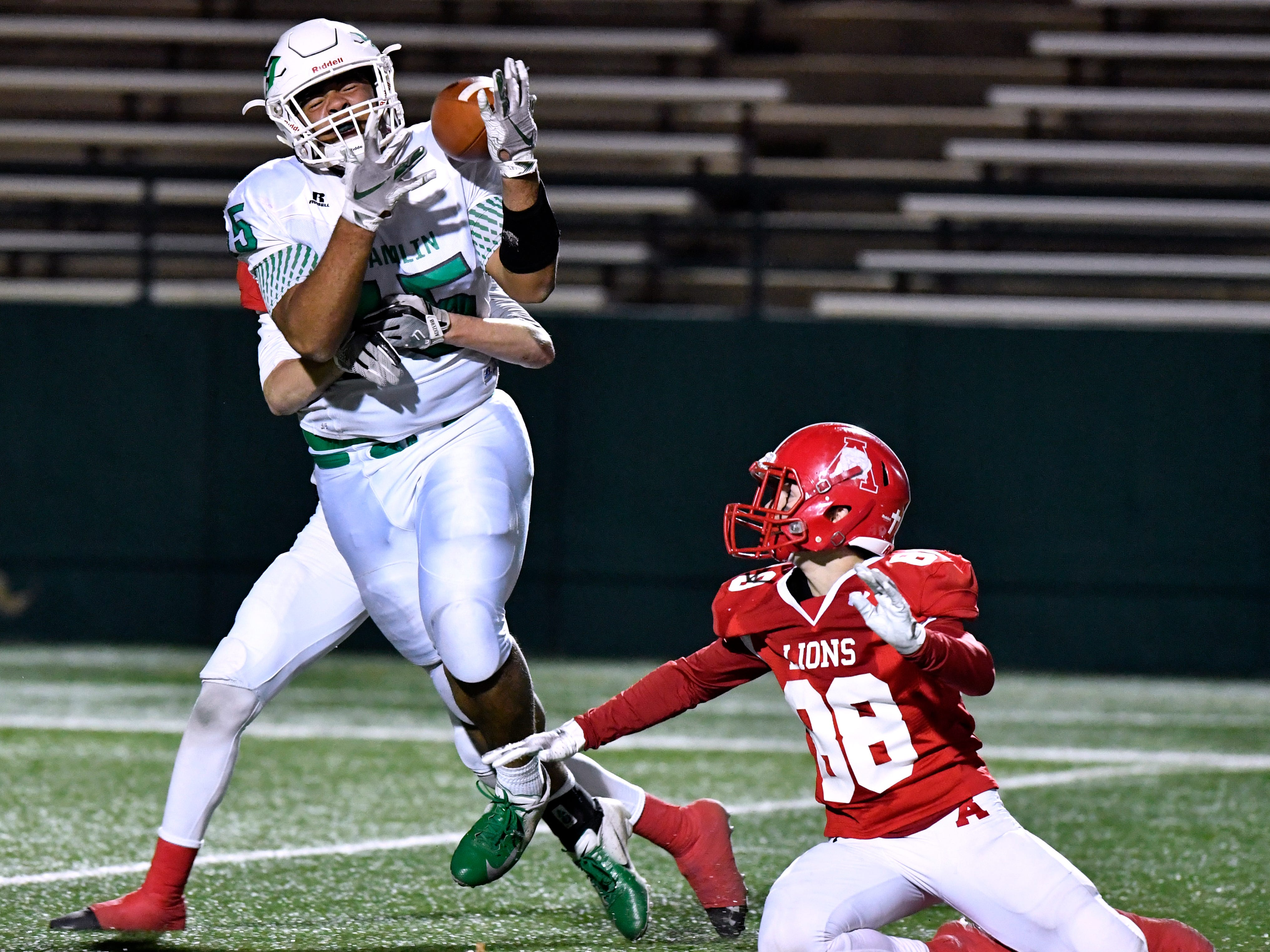 Hamlin tight end Austin Lozano tries to receive a pass but is fouled by an Albany Lion during Thursday's Class 2A Division II quarterfinal game at Shotwell Stadium Dec. 6, 2018. Final score was 41-28, Albany.
