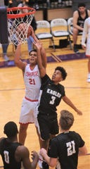Cooper's Kaden Davis (21) drives to the basket as Abilene High's Jalen McGee (3) defends. Cooper beat the Eagles 69-65 at the Catclaw Classic on Friday, Dec. 7, 2018, at Wylie's Bulldog Gym.
