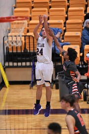 Wylie guard Duncan Bacon (24) follows through on a 3-point shot during a 58-38 win against Brook Hill on the second day of the Catclaw Classic at Bulldog Gym. The tournament wraps up on Saturday.