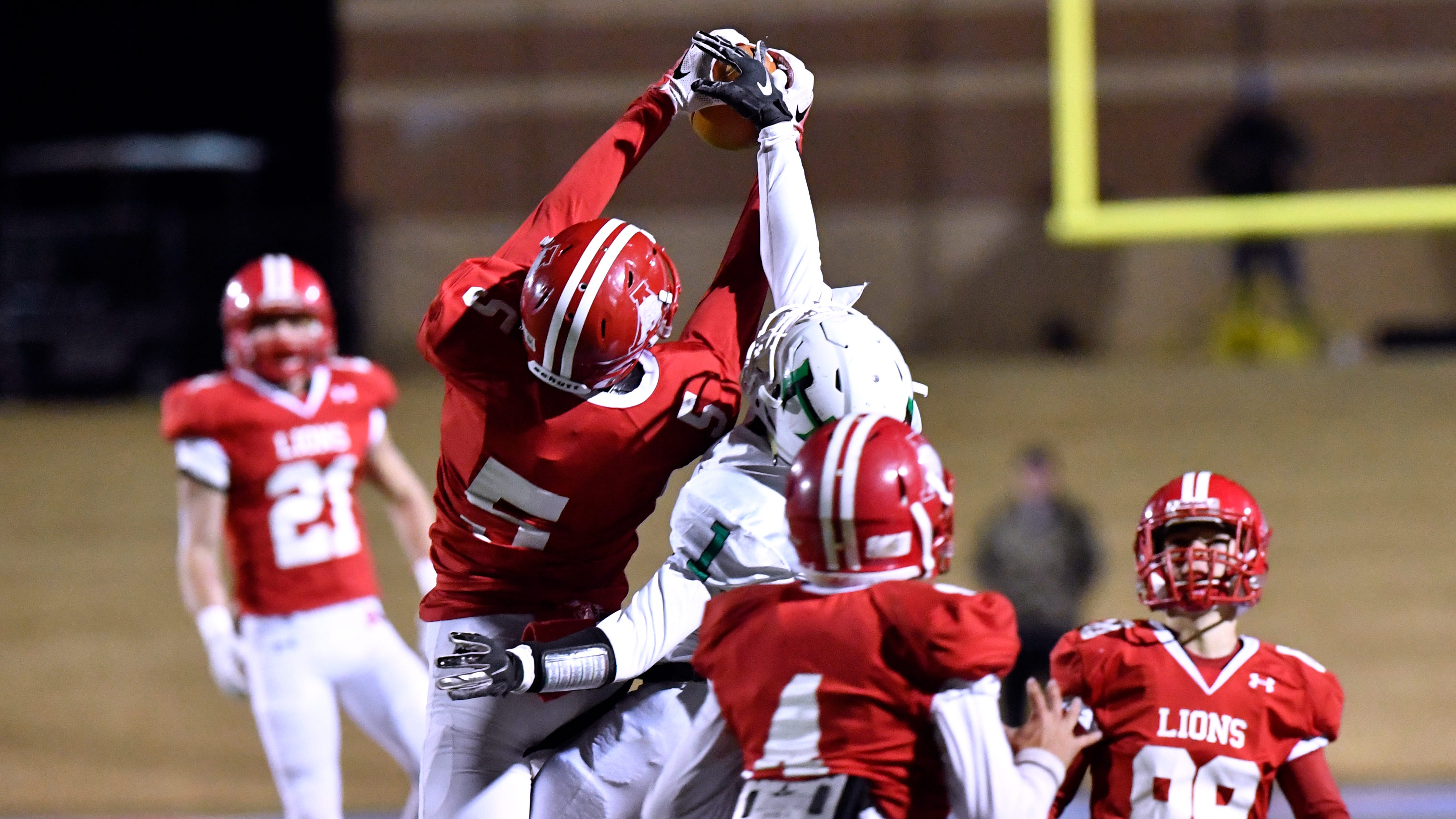 Albany safety Cameron Dacus intercepts a pass meant for Hamlin wide receiver Jevon Williams during the first quarter of Thursday's Class 2A Division II quarterfinal game at Shotwell Stadium Dec. 6, 2018. Final score was 41-28, Albany.