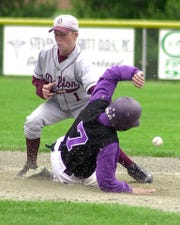 In this 2000 district semifinal, Lakeview's Frank Ballard, who had two home runs in the game, steals second base against Delton Kellogg.