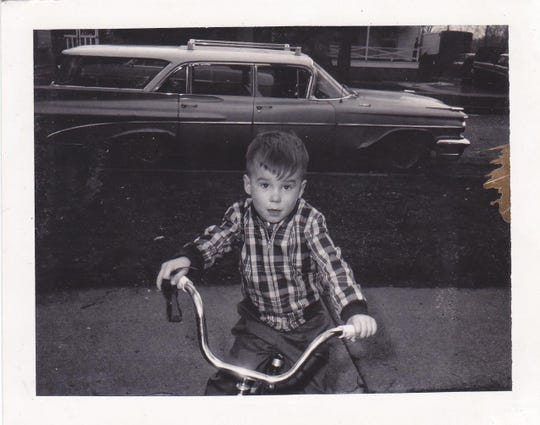 This undated photo shows a young Ron McDonald of Battle Creek on a bike.