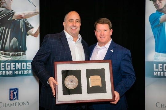Dick's Sporting Goods Open tournament director John Karedes with PGA TOUR Champions president Miller Brady during an awards ceremony held Dec. 6 in Palm Springs, Calif.