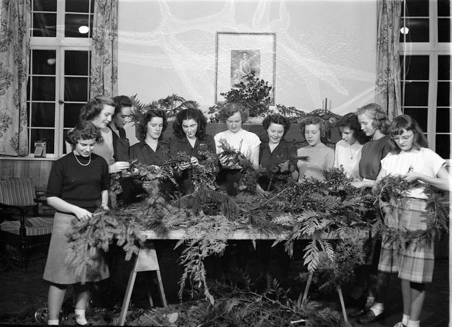Girl Scouts assemble Christmas wreaths with fresh greens in the Scout hall at 11th and Warren Streets in Bremerton. The local home for Girl Scouts for 70 years, the building was built in 1937 by the federal government's Works Progress Administration. The Kiwanis Club, Girl Scouts and Camp Fire used the space rent-free, but paid for maintenance. To see more photos from the Kitsap County Historical Society Museum archives, visit facebook.com/kitsaphistory, kitsapmuseum.org, or stop by the museum at 280 Fourth St. in Bremerton. Call 360-479-6226 for information