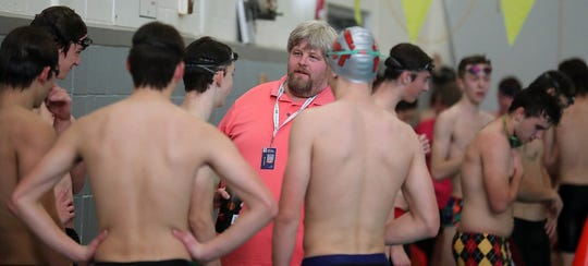 Kingston swimming coach Mark VanHuis talks with his team during a recent practice at the North Kitsap pool.