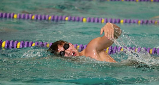 Kingston's Aron Markow practices at the North Kitsap pool in December. The Class 2A/1A West Central District swim/dive championships will be held on Friday. The potential for snow has forced district officials to condense the two-day meet into one day.