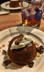 Each course of the Butcher's Table Dinner is served with a drink pairing. The pecan spiced cake served on Dec. 6, featured a spiced cranberry Old Fashioned.