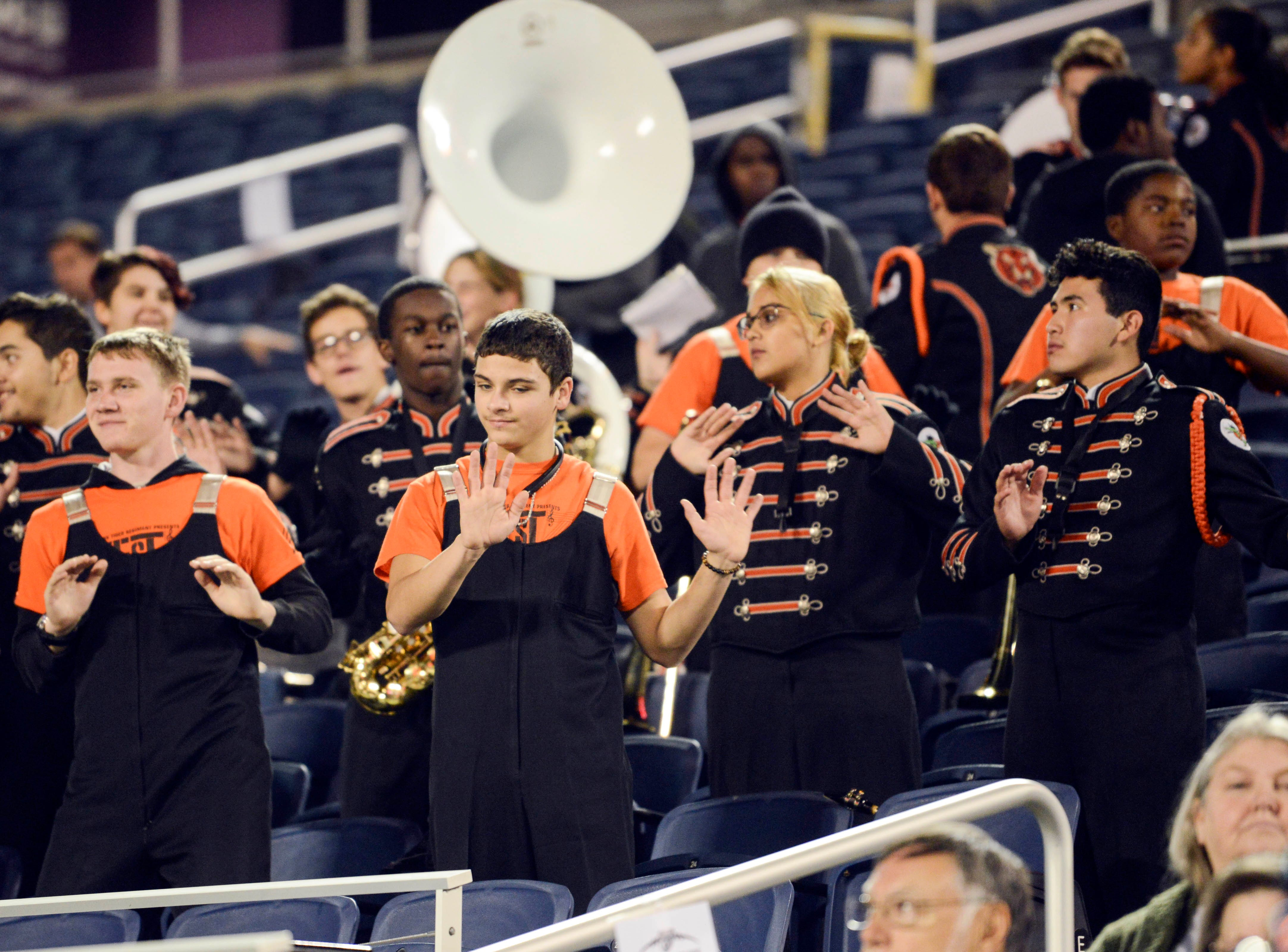 Members of the Cocoa High band perform during Thursday's Class 4A football state championship.