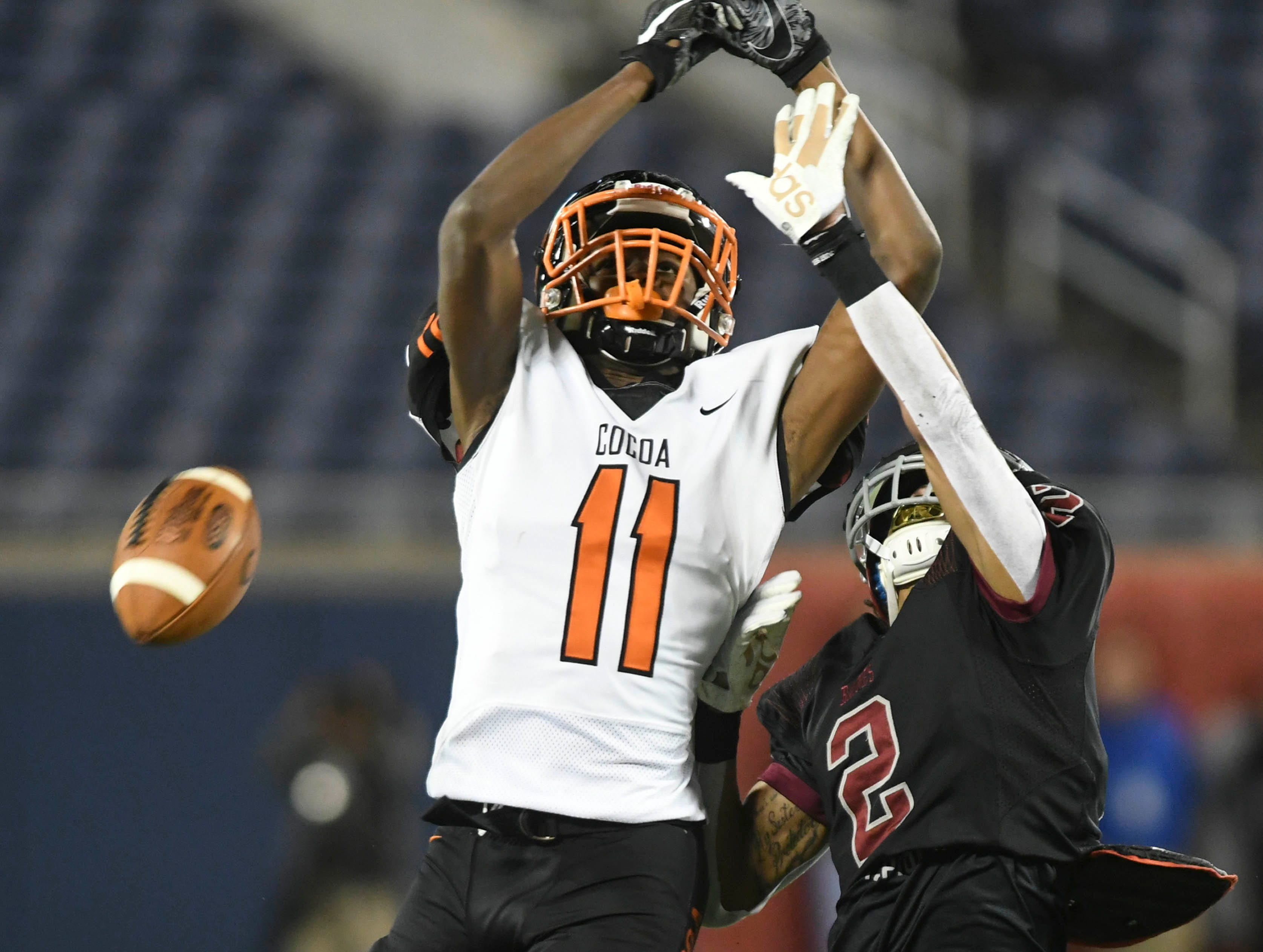 Treyvon Hobbs of Raines breaks up a pass intended for Jamari Williams of Cocoa during Thursday's Class 4A football state championship.